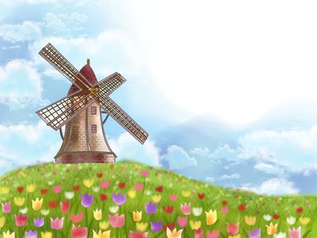 Windmill above a hill