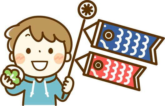 A boy holding a carp streamer and Kashiwa cake