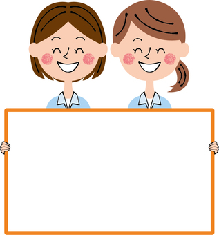 Two women with a worker board smiley