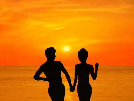 Sea and sunset and couple