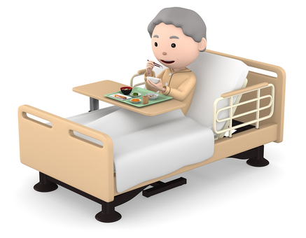 Senior woman eating while in hospital