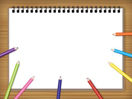 スケッチブックと色鉛筆の背景