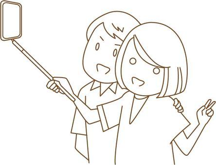 Self-shooting man and woman