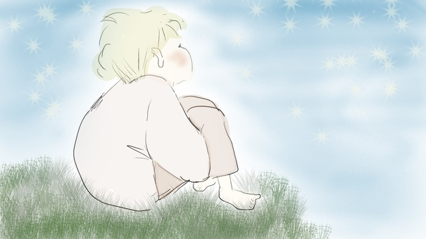 A boy looking up at the starry sky