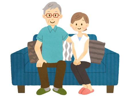 Old couple on sofa