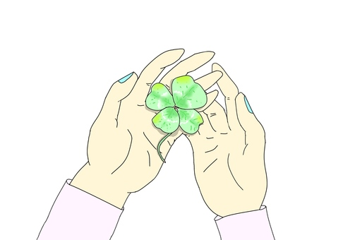 Four-leaf clover in the palm of your hand