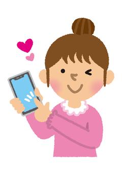 一個操作智能手機的女人