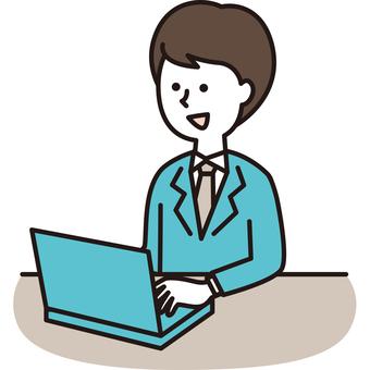 一個穿著西裝使用個人電腦的人