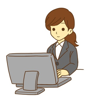 Female office worker working on a personal computer