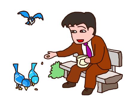 Men feeding pigeons in the park