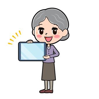 Senior women purple tablet presentation