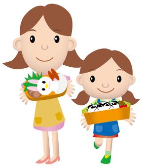 母親和女兒和午餐盒