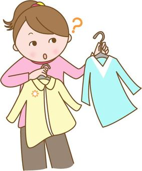 A lost woman in selecting clothes