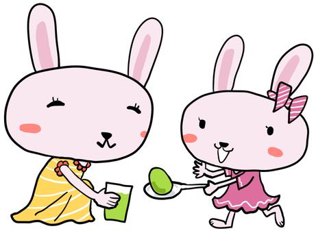 イースターエッグを作るウサギの親子
