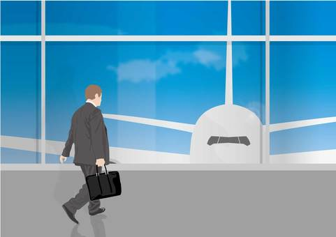 A salaried man heading for a boarding gate