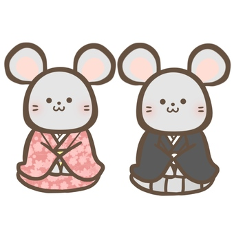 A mouse sitting upright in a kimono and a cape
