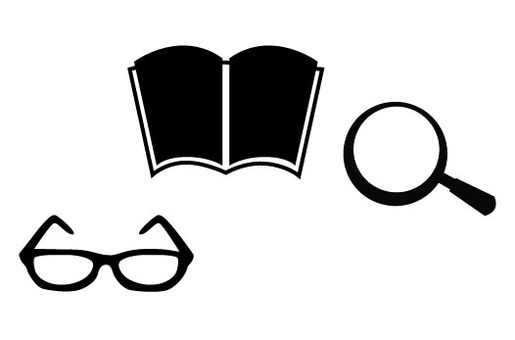 Glasses and magnifying glass then books