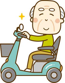 An old man walking with a senior car