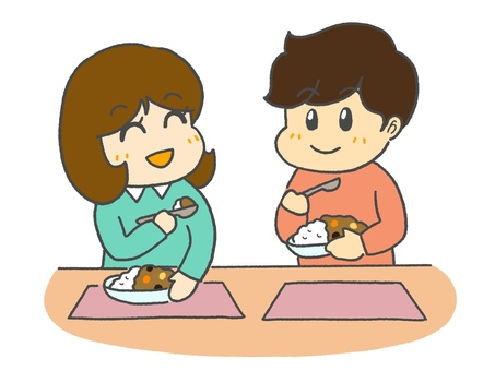 Boy and girl eating curry rice