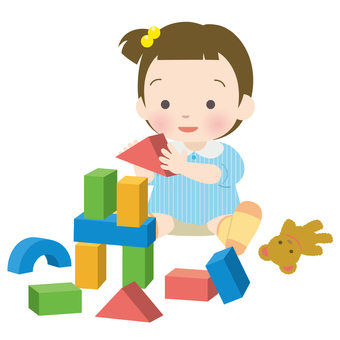 Little girl in summer clothes playing with blocks