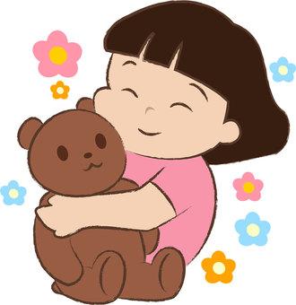 Girl holding a bear