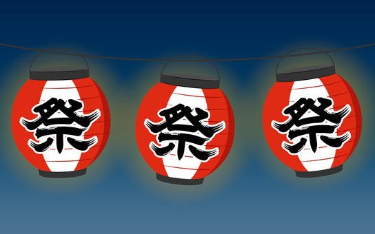A row of red lanterns of the festival floating in the night sky