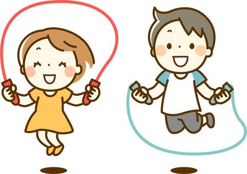 縄跳びを飛ぶ子供