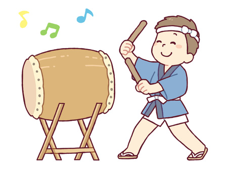 A boy striking a drum