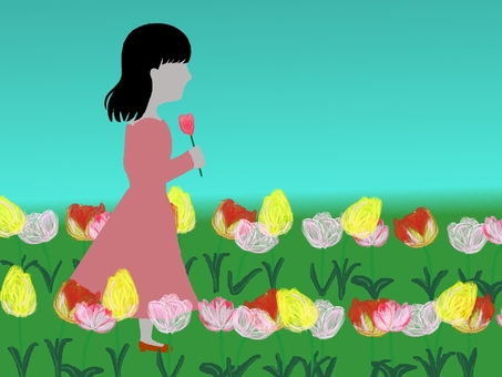 Tulips and women under blue sky