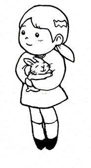 A girl holding a rabbit