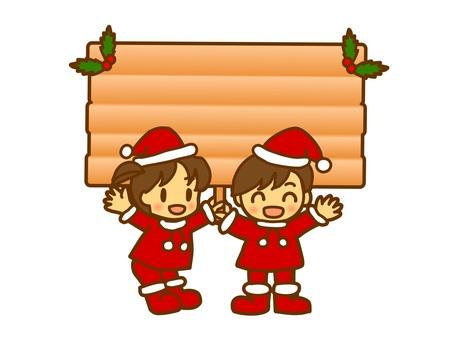 크리스마스 간판을 내거는 아이들