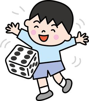 A boy rolling a dice
