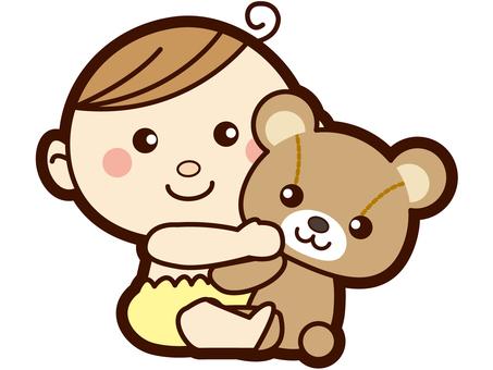 Baby holding bear's stuffed animal