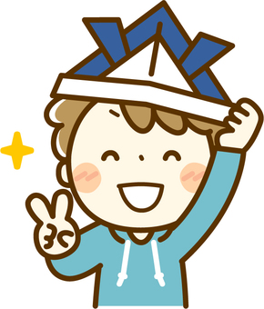 A boy who is happy to wear an origami helmet