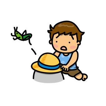 메뚜기를 잡으려고하는 소년