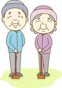 Elderly couple / gate ball