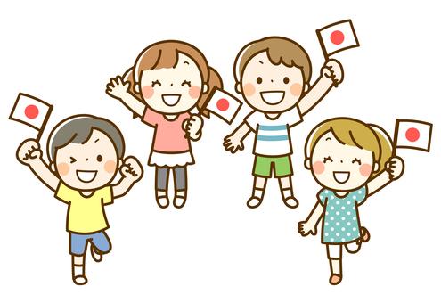 日本の国旗を持って応援する子供たち