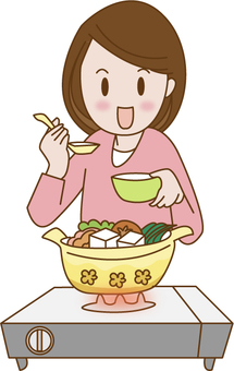 A woman eating hot pot dishes