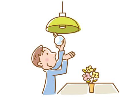 Man replacing light bulb