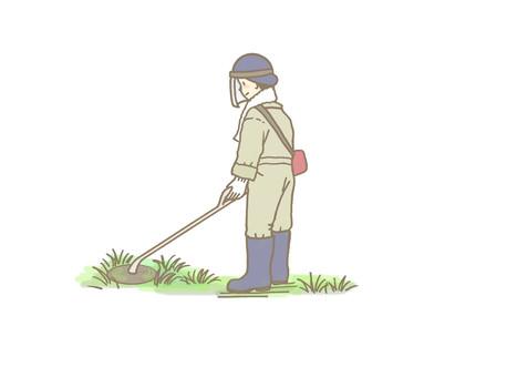 草刈り機で刈るひと