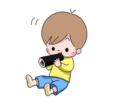 Boy eating ehomaki