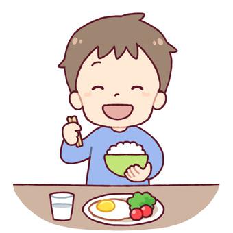 一個吃米飯的男孩